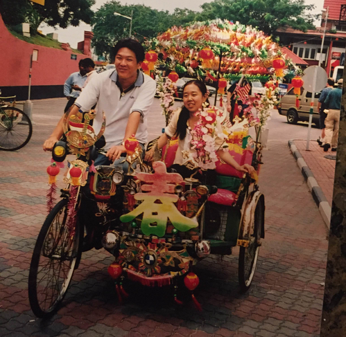 riding a rickshaw in Malaysia